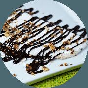 Tapioca: Chocolate (Doce mais pedida) - Tapioca (Ingredientes: Chocolate 50% cacau com leite condensado sem lactose, Pedaços de Bis)