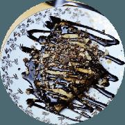 Crepe: Crepe Chocolate (Opção doce mais pedida) - Crepe (Ingredientes: Chocolate 50% cacau com leite condensado, Pedaços de Bis, Sem lactose)