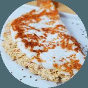 Tapioca: Frango Cremoso (Campeã de Satisfação) - Tapioca (Ingredientes: Creme especial de ricota, Frango temperado desfiado, Tomate marinado)